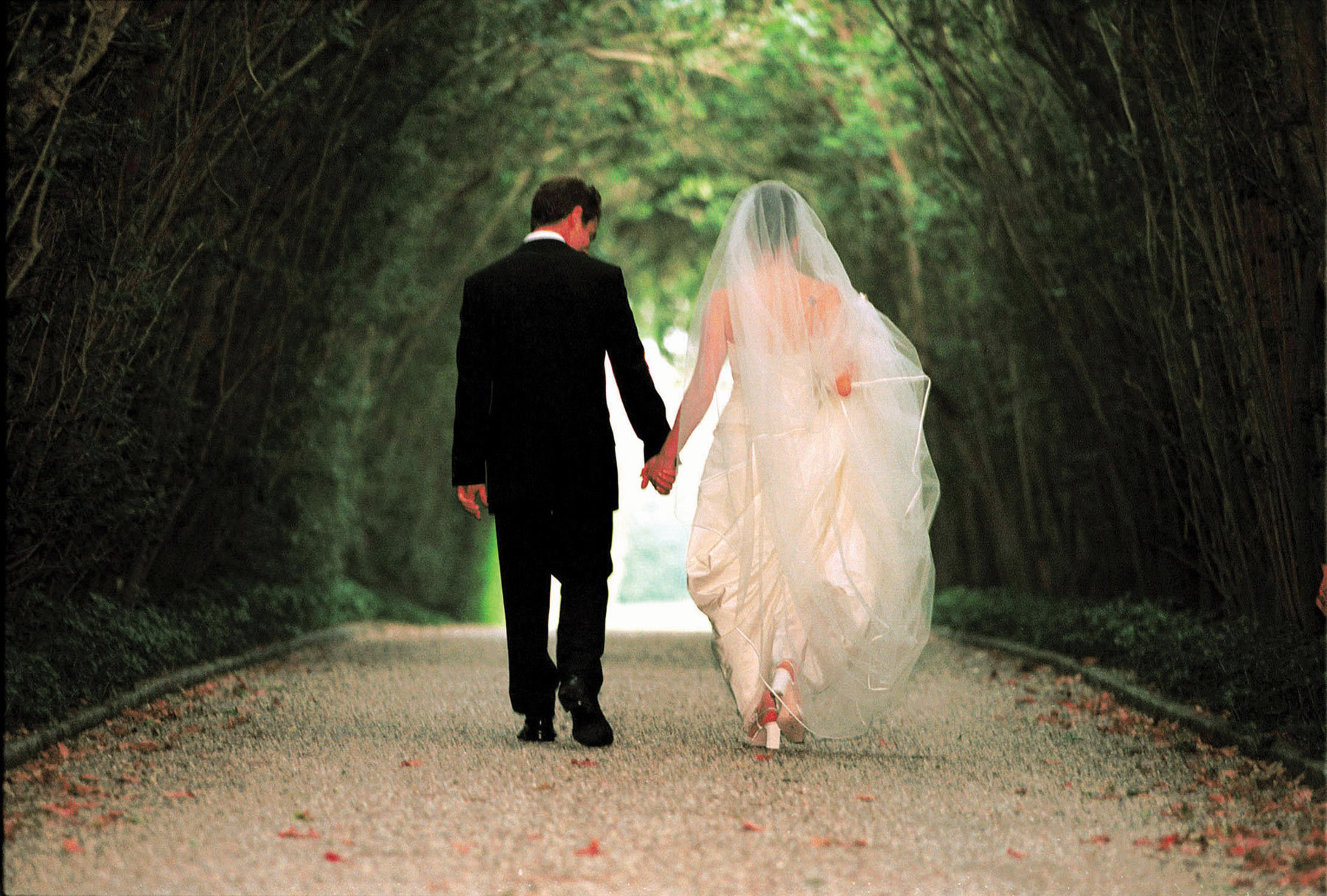 Bride and groom holding hands - planning fights to avoid
