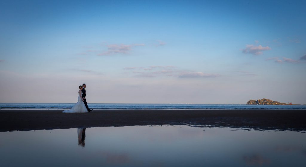 Portmarnock Hotel & Golf Links Beach view with couple
