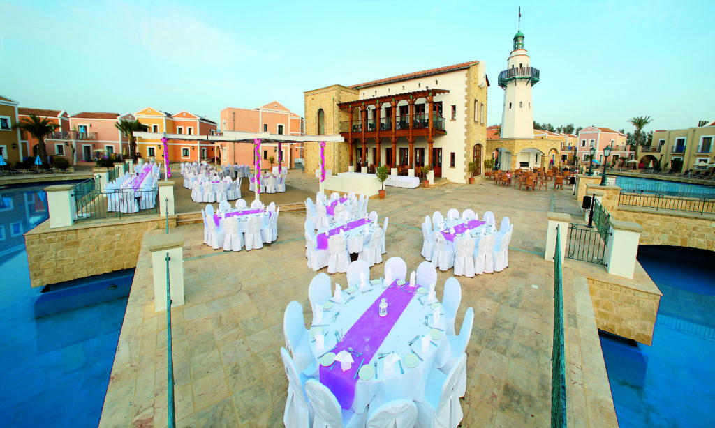 Wedding reception in Cyprus with TUI. Pink. White. Tables and Chairs. Waterfront.