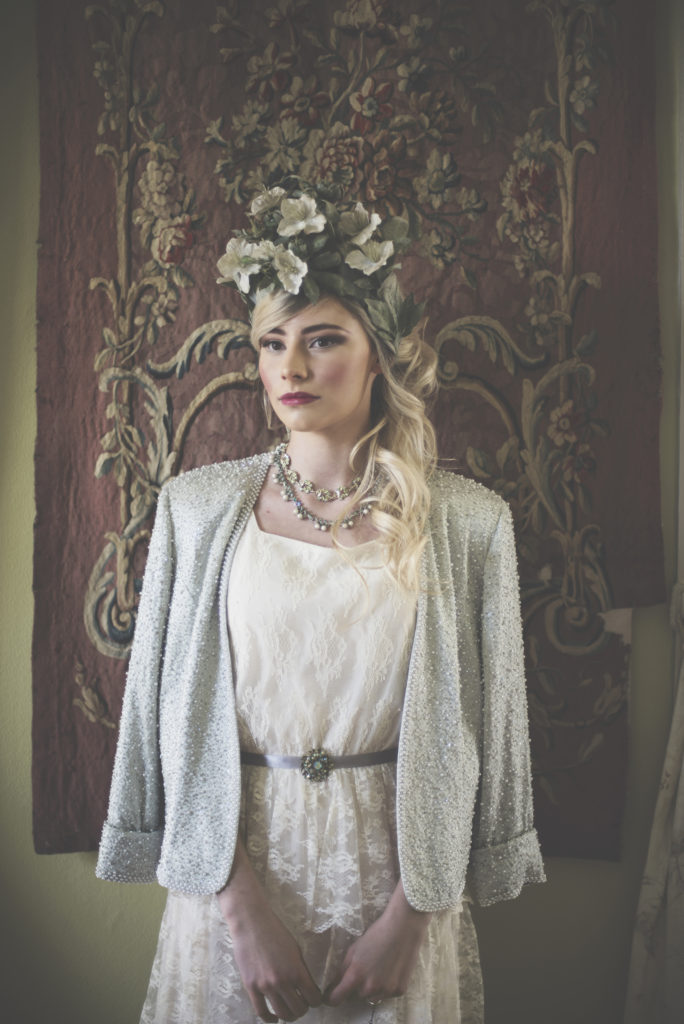 Bride with floral crown. Dress and Jacket. Belt with Brooch.