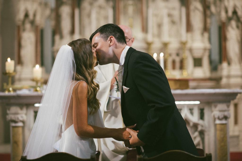 Ali and Ronan at Carton House. Bride and Groom kiss.