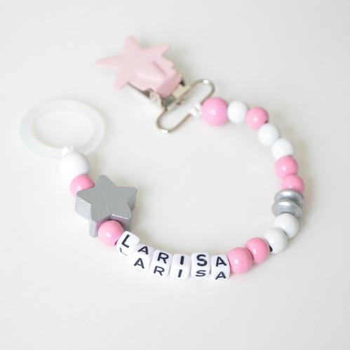rosa napphållare med pärlor