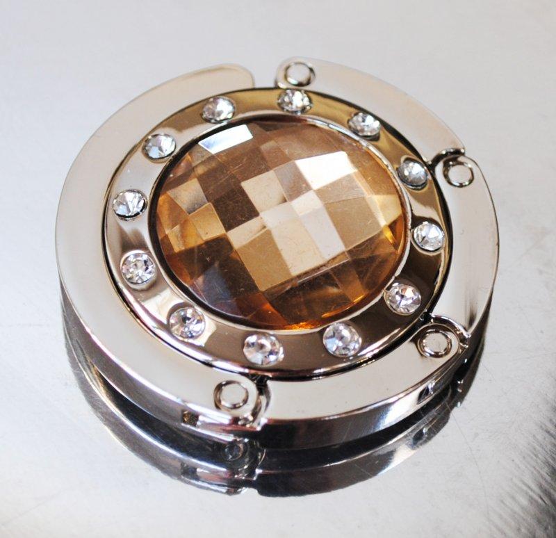 Väskhängare i silver och guld