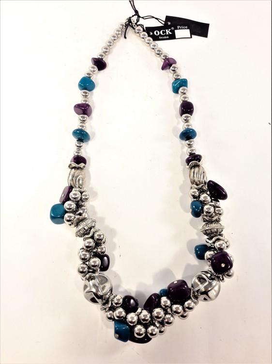 Kraftigt halsband med silverfärgade, turkosa och lila detaljer