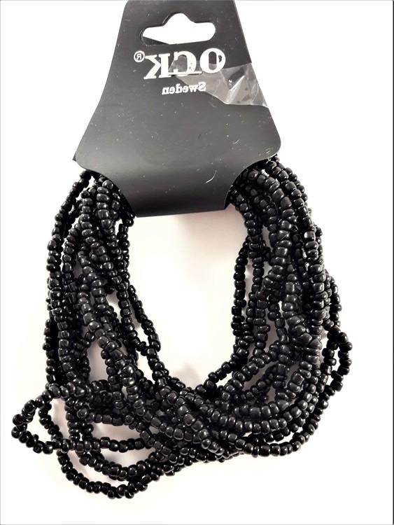 Flerradigt armband av små svarta pärlor
