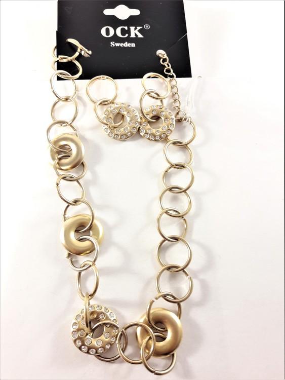 Dekorativt och vackert lyxhalsband och örhängen, guldfärgat med strass