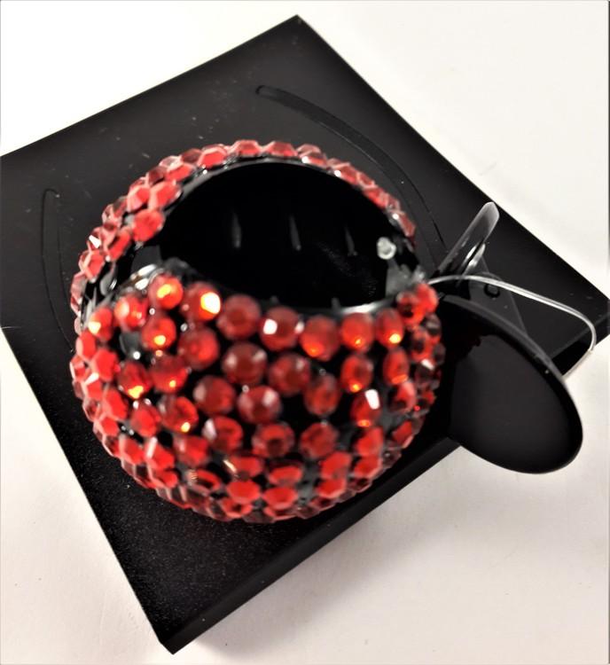 Rund hårklämma med glittrande detaljer i rött