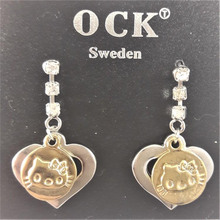 Söta örhängen med silverfärgade hjärtan och guldfärgade katthuvuden samt strass