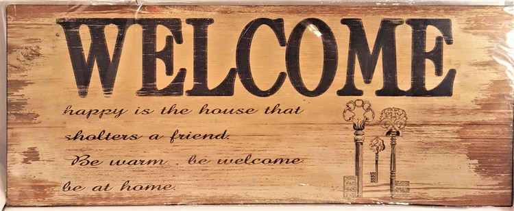 "Plåttavla med texten ""Welcome""."