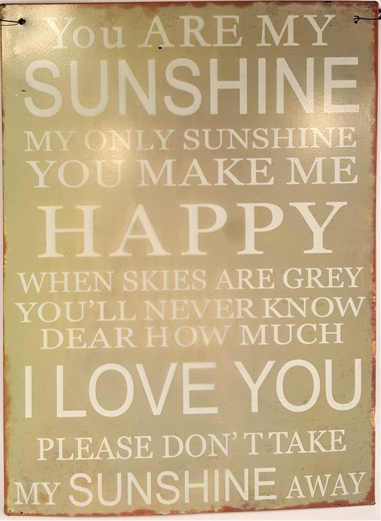 "Plåttavla med texten ""You are my sunshine...""."