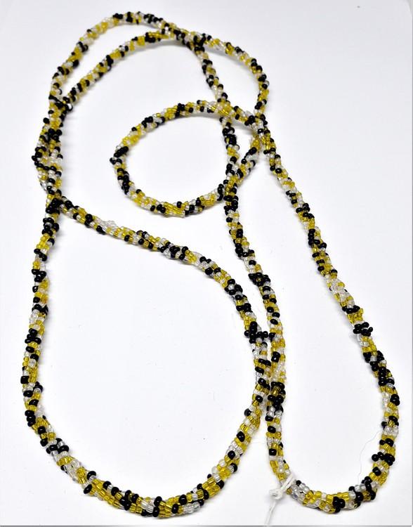 Långt halsband med små kulor i gula och svarta toner