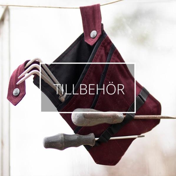 En avtagbar verktygsficka med skruvmejslar hänger på en lina