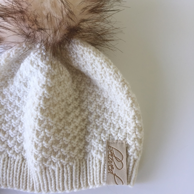 Handknitted merino wool pompom hat, offwhite