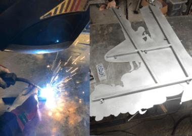 Svetsarbete och stålkonstruktion för en skylt.
