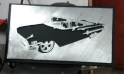 Tavla med motiv av en Impala 1960.