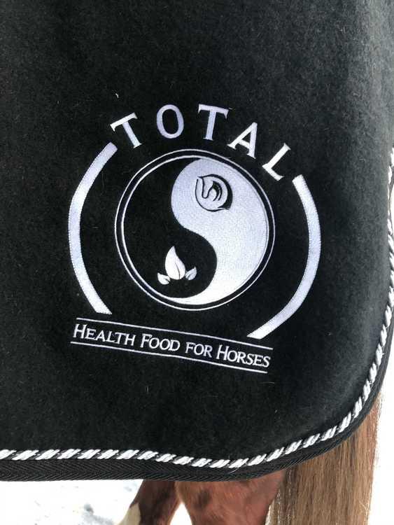 Ylletäcke med TOTAL Logotype