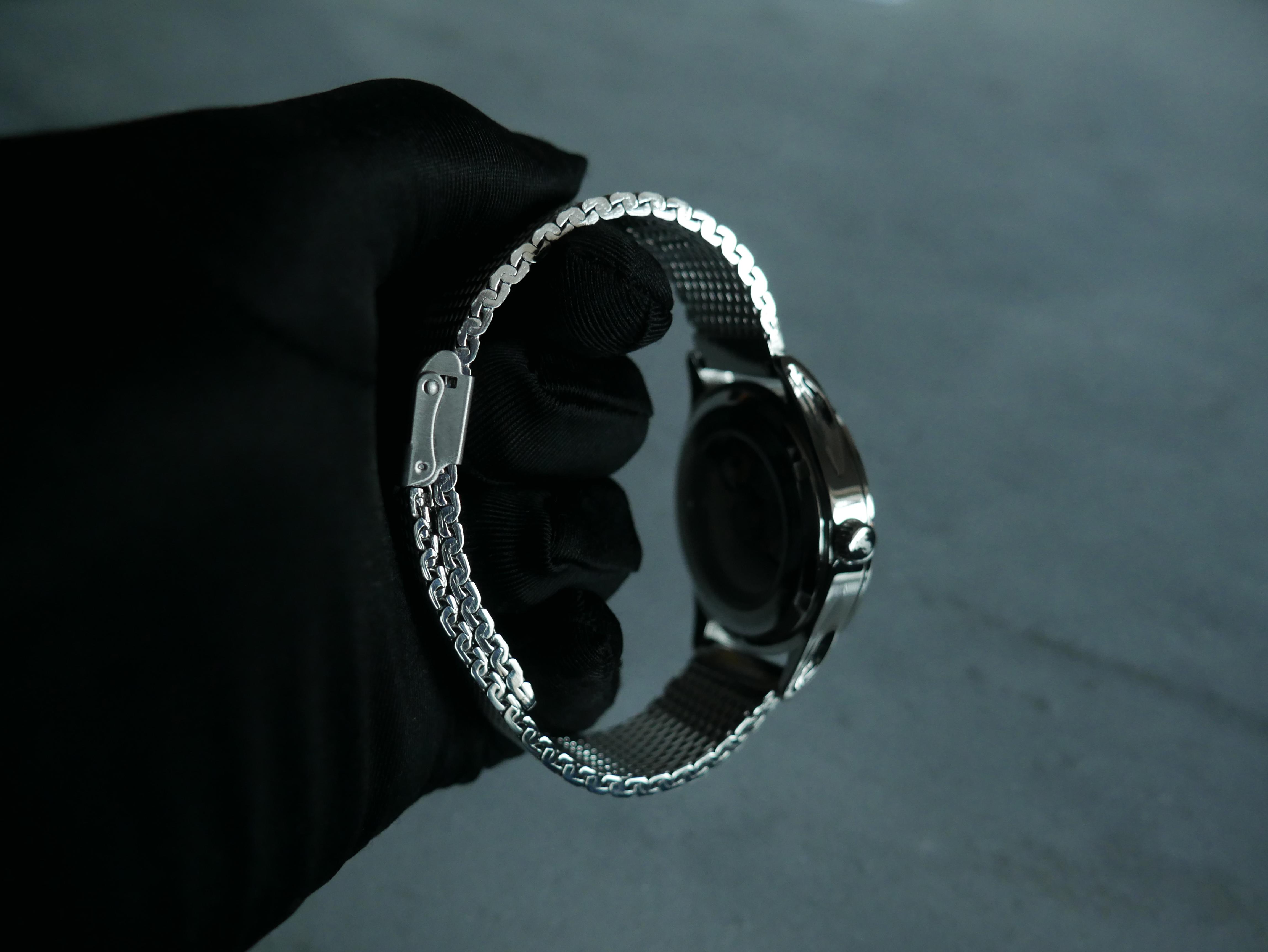 Lindskog Sweden klocka stainless steel svart handske