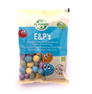 Påse med choklad doppade jordnötter, med färgglad överdrag av sockerlager. Ekologiska & Fair Trade. Endast naturliga frukt- & växtextrakt.