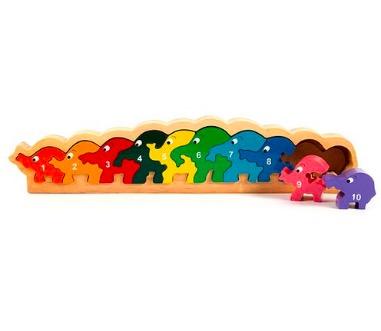 Pussel i ram med elefanter på rad i klara färger numrerade från 1 - 10. Fairwood.