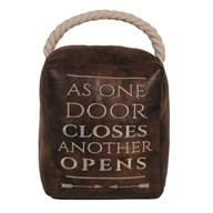 As One Door Closes Cube Door Stop Brown 16cm