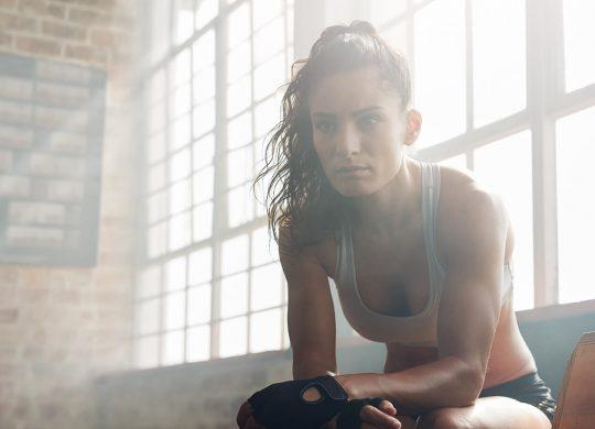 Female sat in a gym