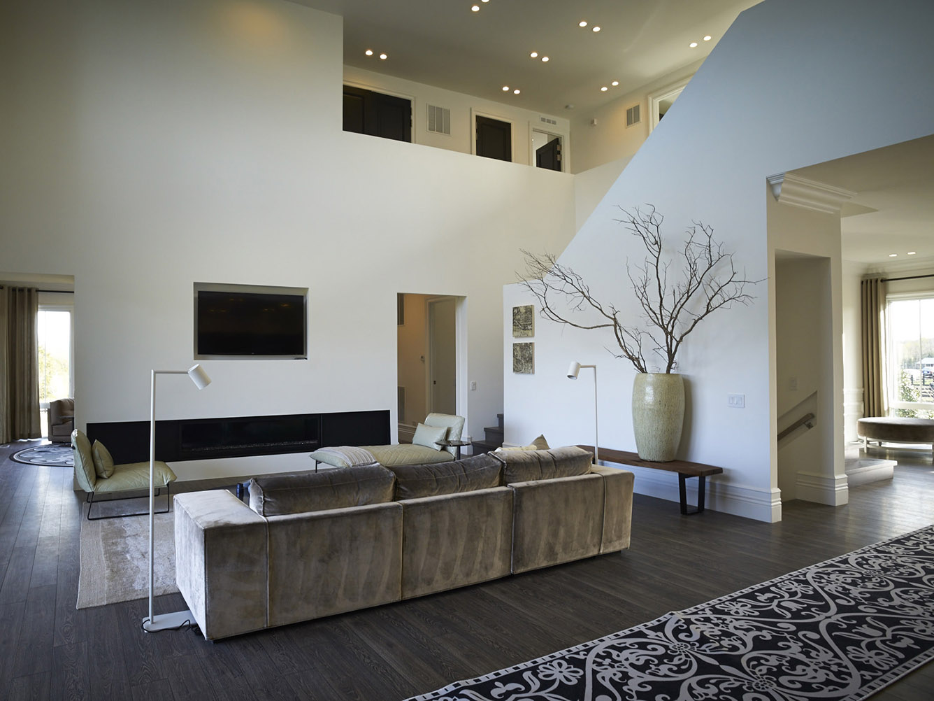 Hovnanian homes at Willowsford with DIEKE sofa, KEKKE longchair and armchair and TRIBE lighting by Maretti