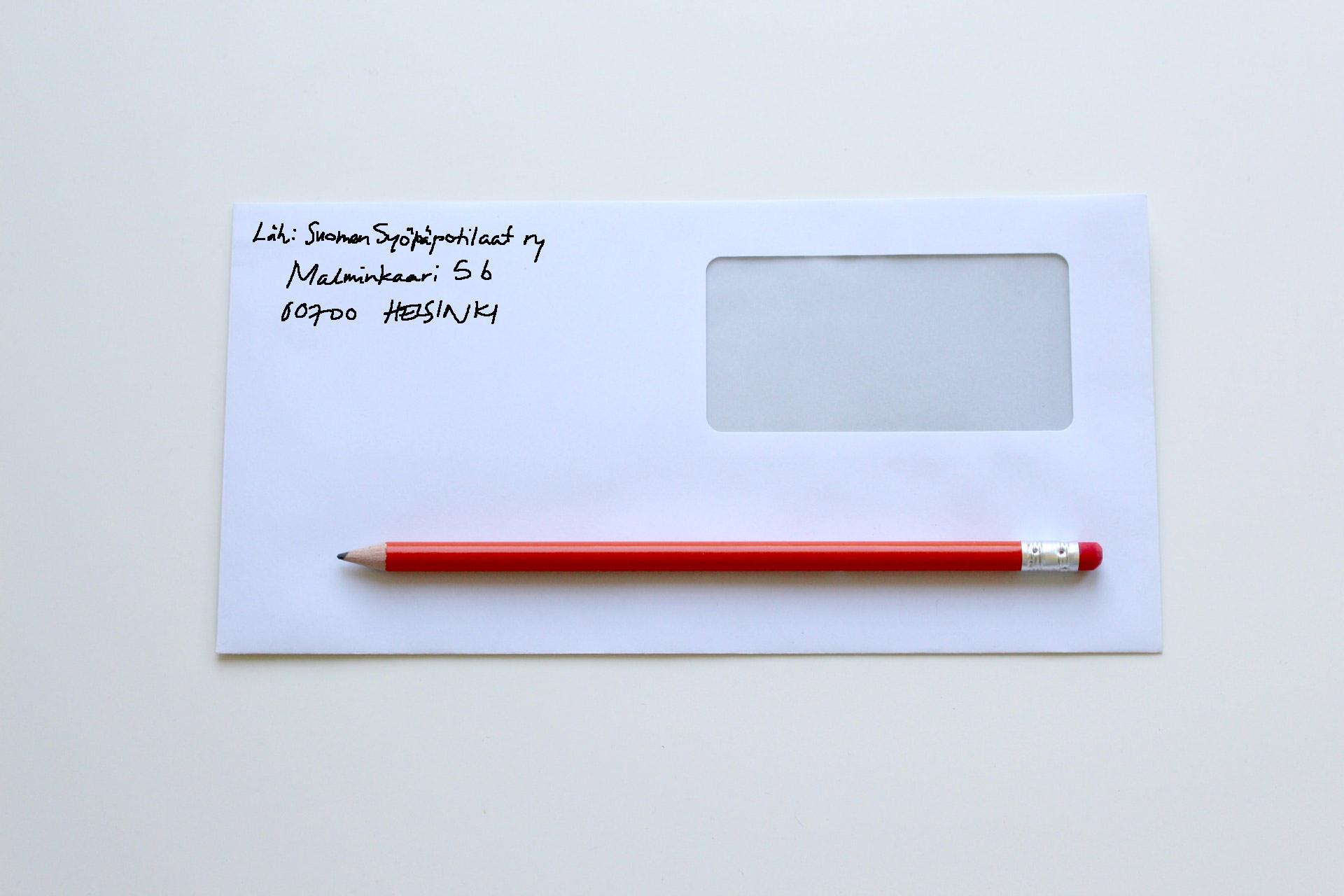 Kirjekuori, jonka lähettäjä Suomen Syöpäpotilaat ry sekä punainen kynä