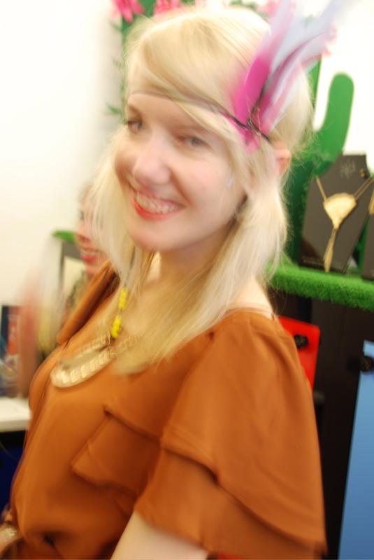 Lisa in feather headdress