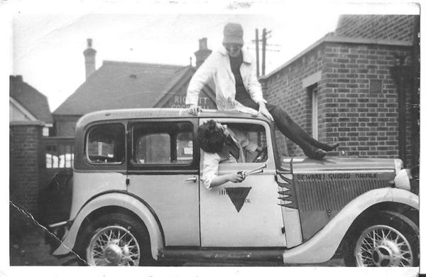 Harriet's mum on top of a car