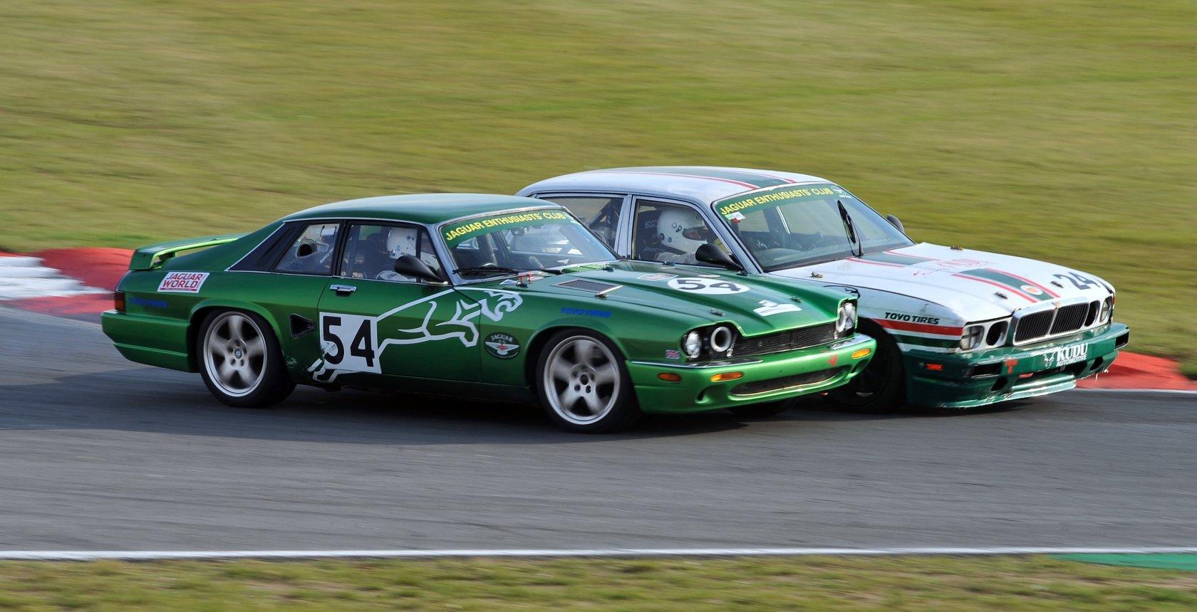 Close Racing Between Mike Seabourne Xj40 And Rick Walker Xjs Around Coram