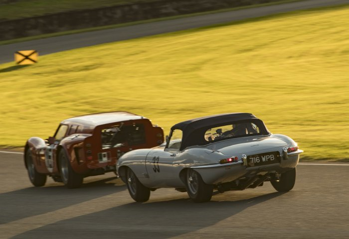 E Type Chases Ferrari Into The Sunset Cg