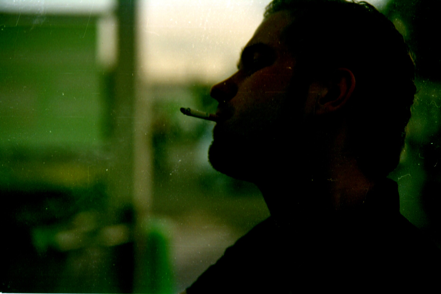 man smoking, taken with Centon DF-300, Vivitar 35-105mm, Tudor film.