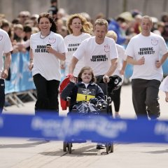 Kirsty & Team Crossing the Finish Line