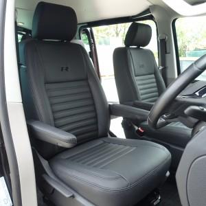 Black leather volkswagen transporter seat with black horizontal stitching