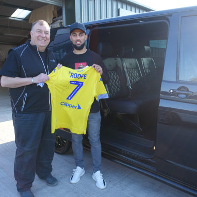 Paul our MD and Kemar Roofe with a signed Leeds United shirt outside his reupholstered VW T6