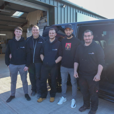 Leeds United FC Striker, Kemar Roofe, standing with the Seat Surgeons Team outside his freshly trimmed Volkswagen Transporter T6 Van.