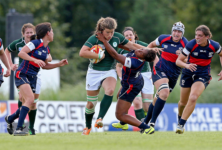 "2014 Women's Rugby World Cup Pool B, FFR HQ, Marcoussis, Paris, France 1/8/2014 USA vs Ireland Ireland's Jenny Murphy hands off Akalaini ""Bui"" Baravilala of USA Mandatory Credit A�INPHO/Dan Sheridan"