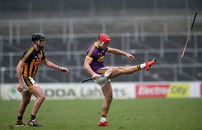 Bord na Mona Walsh Cup Final, Nowlan Park, Kilkenny 20/1/2018 Kilkenny vs Wexford. Wexford's Lee Chin kicks Kilkenny's Conor O'Shea's hurl out of play Mandatory Credit ©INPHO/Ryan Byrne