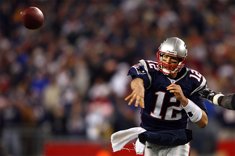 AFC Divisional Playoff 12/1/2008 New England Patriots Quarterback Tom Brady throws a pass Mandatory Credit ©INPHO/Getty Images