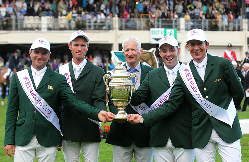 Cian O'Connor | The Sports Chronicle | 2012 Dublin Horse Show 17/8/2012 The FEI Nations Cup | The victorious Irish Team | Chef d'Equipe Robert Splaine with the Aga Khan trophy and riders from left, Darragh Kerins, Richie Moloney, Cian O'Connor and Clem McMahon | Mandatory Credit ©INPHO/Lorraine O'Sullivan