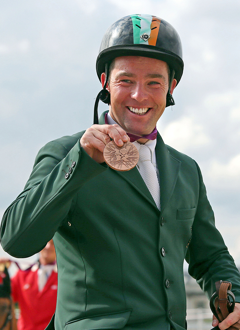 Cian O'Connor. Equestrian, London 2012 Olympic Games, Greenwich Park, London, England 8/8/2012 | Individual Jumping Final | Ireland's Cian O'Connor celebrates with his bronze medal on | Blue Lloyd 12 | Mandatory Credit ©INPHO/Morgan Treacy
