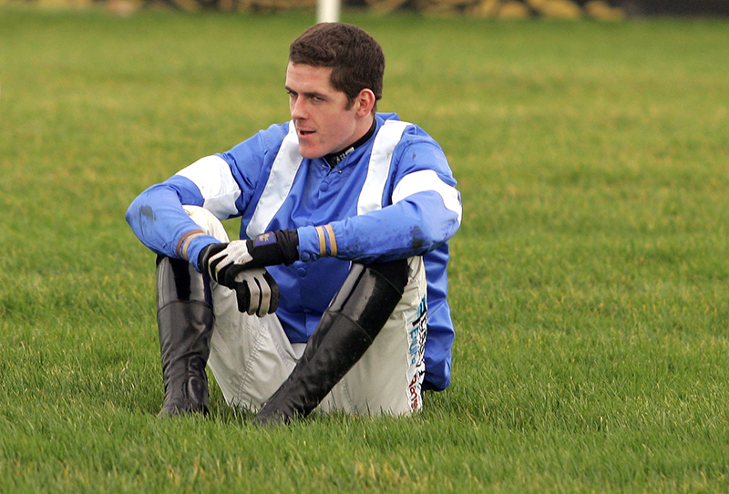 Leopardstown Festival 26/12/2007 Andrew McNamara reflects after falling at the last while leading the The Durkan New Homes Maiden Hurdle Mandatory Credit ©INPHO/James Crombie