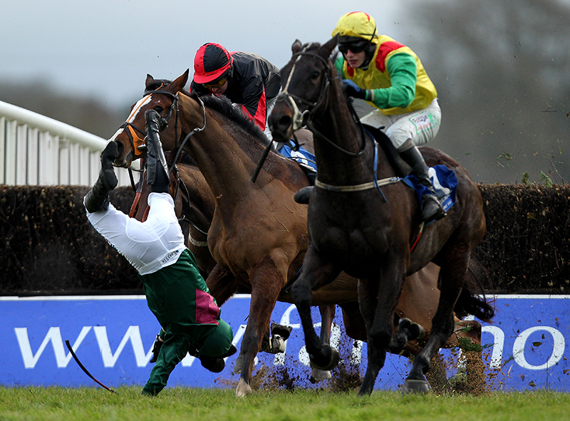 Fairyhouse Racing 1/1/2011 Jockey Andrew McNamara parts company with Rocco's Hall as race winner Droim Toll ridden by Paul Townend (yellow) goes clear during the Porterstown Handicap Steeplechase Mandatory Credit ©INPHO/James Crombie