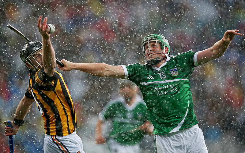 Inpho Pictures of the Year 2014 19/12/2014 GAA Hurling All Ireland Senior Championship Semi-Final 10/8/2014 Kilkenny vs Limerick JJ Delaney of Kilkenny with Shane Dowling of Limerick Mandatory Credit ©INPHO/Donall Farmer
