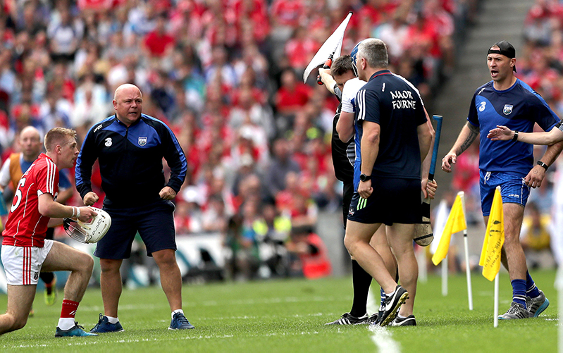 All-Ireland Senior Hurling Championship Semi-Final, Croke Park, Dublin 13/8/2017 Cork vs Waterford Cork's Luke Meade replaces his helmet following a tackle by Austin Gleeson of Waterford as manager Derek McGrath looks on Mandatory Credit ©INPHO/James Crombie