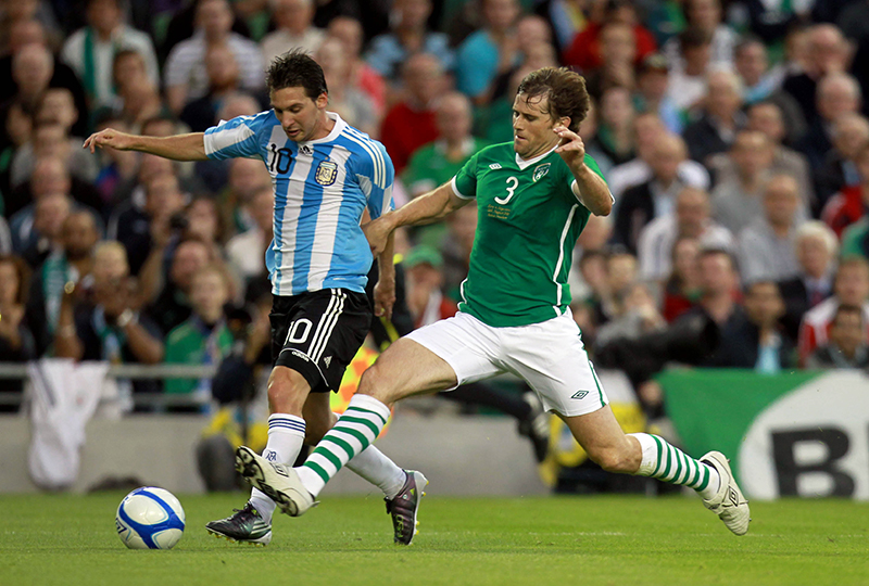 International Friendly 11/8/2010 Republic of Ireland vs Argentina Ireland's Kevin Kilbane with Lionel Messi of Argentina Mandatory Credit ©INPHO/Donall Farmer