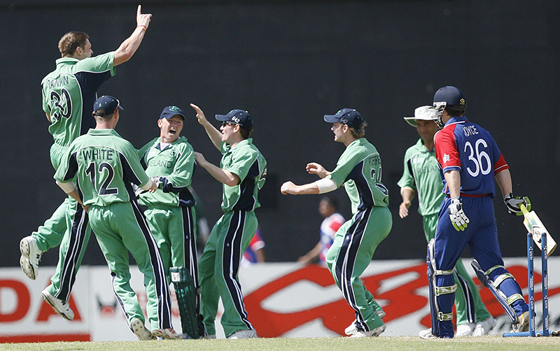 Super Eight Cricket World Cup, Guyana, 30/3/2007 Ireland vs England Ireland's Boyd Rankin (L) celebrates the wicket of England's Ed Joyce (R) with team-mates during the Super-Eight match Mandatory Credit ©INPHO/GettyImages/Adrian Dennis