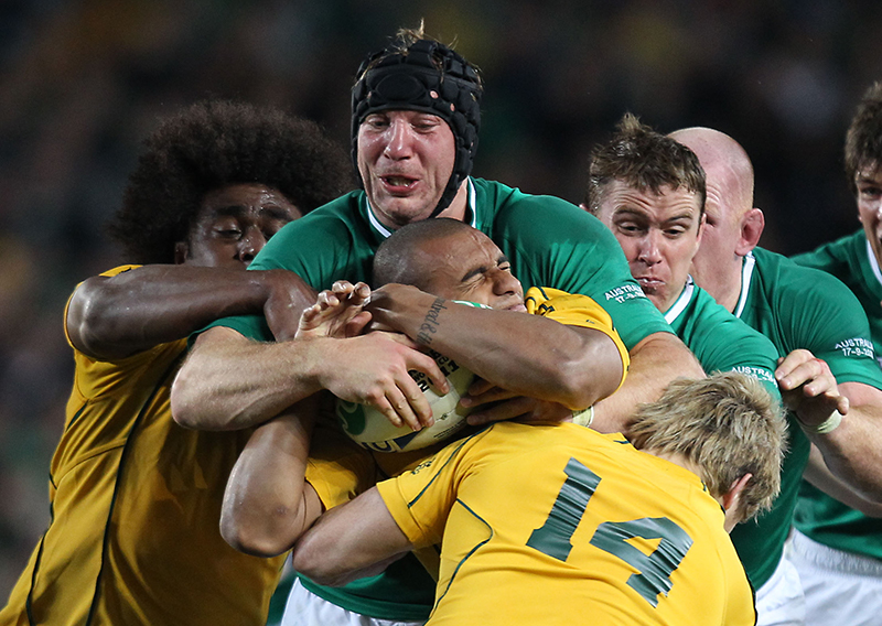 Rugby World Cup Preview 17/9/2015.2011 Rugby World Cup.Australia vs Ireland.Will Genia under pressure from Stephen Ferris.Mandatory Credit ©INPHO/Billy Stickland