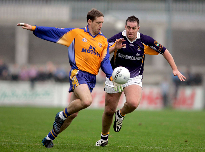 Dublin Senior Football Championship Final 16/10/2005 Kilmacud Crokes vs Na Fianna's Kilmacud Crokes's Johnny Magee and Na Fianna's Kieran McGeeney Mandatory Credit ©INPHO/ Tom Honan