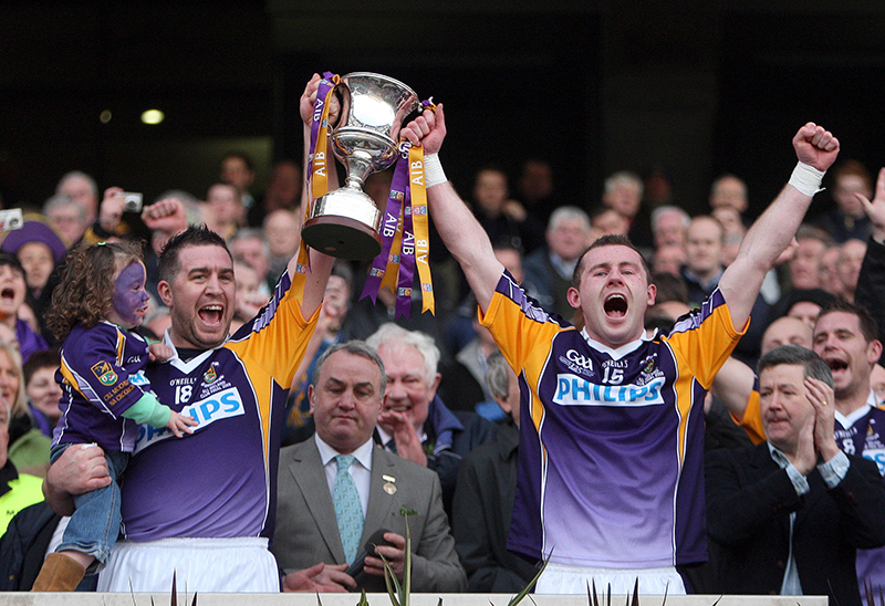AIB All Ireland Senior Club Football Championship Final 17/3/2009 Kilmacud Crokes Captain Johnny Magee and Pat Burke lift the cup Mandatory Credit ©INPHO/Donall Farmer